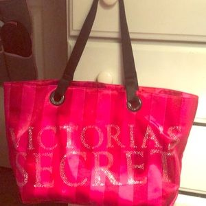 Pink and red Victoria Secret tote.